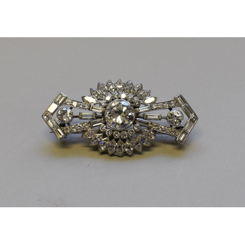298 - <strong>An Art Deco old European cut diamond brooch,</strong>the central stone of approximately 2ct...