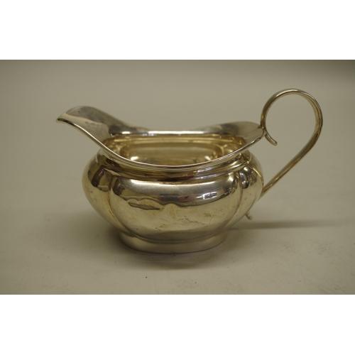 1 - <strong>A silver three piece teaset,</strong> by<em>J</em><em>oseph Gloster Ltd</em>, Birmingh...