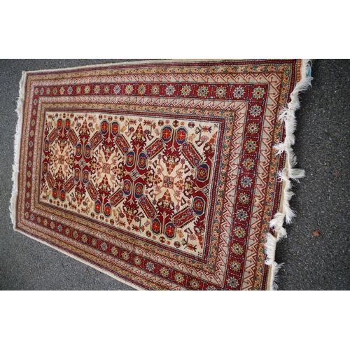 1102 - <strong>A Caucasian rug,</strong>having three central medallions, with allover floral and geom...