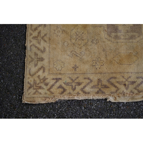 1105 - <strong>A pair of Persian rugs,</strong>having three medallions and animal motifs to central field,...