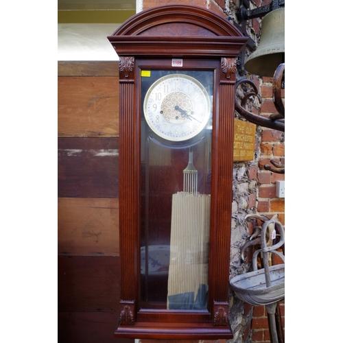 1109 - <strong>A reproduction mahogany Vienna style wall clock,</strong>the dial inscribed 'Howard Mi...