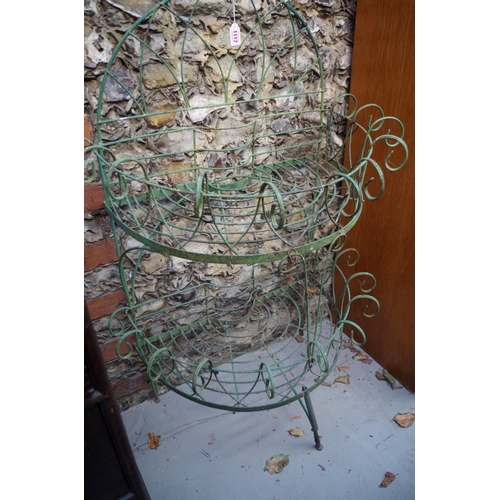 1117 - <strong>A green painted wirework semi circular two tier planter, </strong>109cm high x 75cm wid...