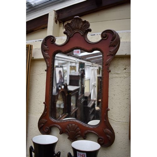 1130 - <strong>An 18th century style red lacquered and parcel gilt wall mirror,</strong>57.5cm high.&...