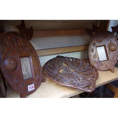 1136 - <strong>A pair of Scandinavian carved birch easel back photograph frames,</strong>31cm high; t...