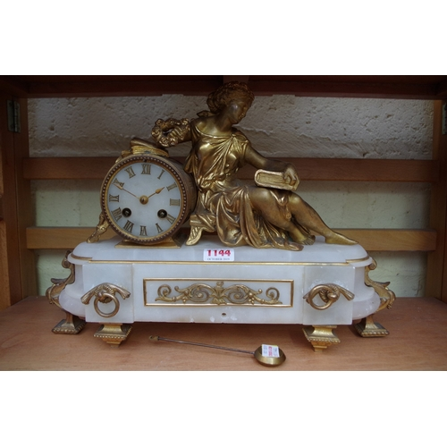 1144 - <strong>A late 19th century alabaster and gilt metal figural mantel clock,</strong>the bell st...