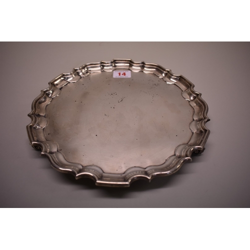 14 - <strong>An Edwardian silver salver,</strong> by <em>Henry Stratford Ltd, </em>London 1902, 25.5cm di...