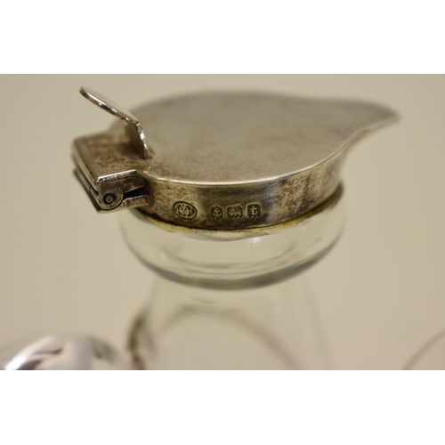 18 - <strong>Two silver mounted chota pegs,</strong> by <em>Hukin & Heath</em>, Birmingham 1918 &...