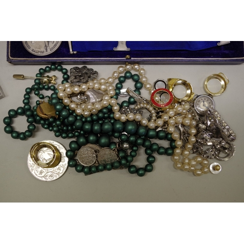 183 - <strong>A bag of mixed items,</strong> to include costume jewellery; watches; coins; and medals....