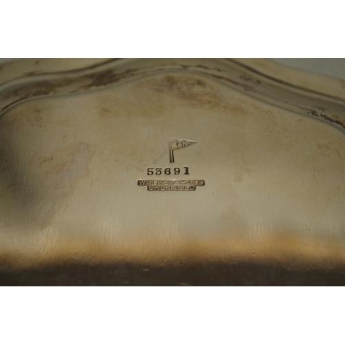 2 - <strong>A silver salver,</strong> by<em>Walker & Hall Ltd,</em>Sheffield 1919, 26cm diameter, ...