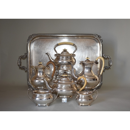20 - <strong>An impressive silver seven piece teaset</strong>, comprising a large twin handled tray, 76cm...