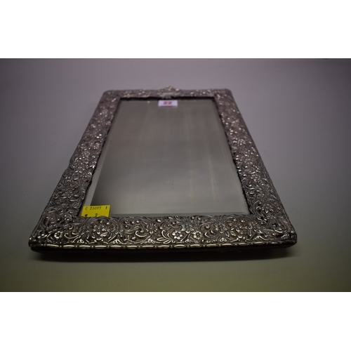 22 - <strong>A Victorian silver embossed easel mirror<em>,</em></strong><em> by Henry Matthews</em>, Birm...