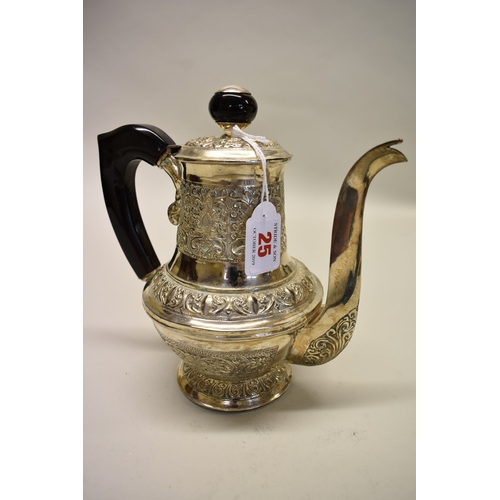 25 - <strong>An Indian white metal baluster coffee pot, </strong>having horn mounts, 21cm....