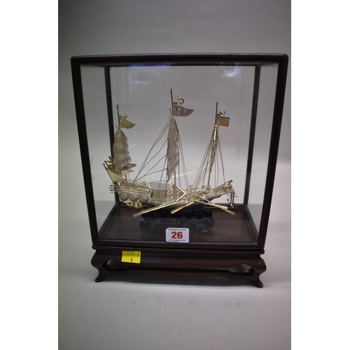26 - <strong>A Chinese silver model of a junk,</strong><em>by Wei Kei,</em> Hong Kong, stamped sterling ...