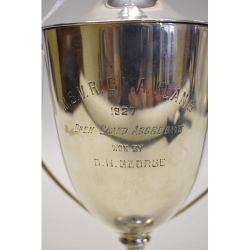 27 - <strong>A silver twin handled cup and cover,</strong> by <em>James Dixon, </em>Sheffield1927, 27cm ...