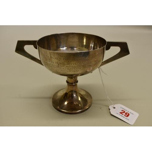 29 - <strong>A silver twin handled trophy cup,</strong> by <em>J</em><em>ohn Taylor & Co</em>, Birmin...