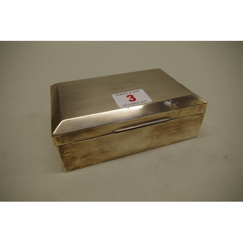 3 - <strong>A silver cigarette box,</strong> by <em>Barker Bros Silver Ltd, </em>Birmingham 19...