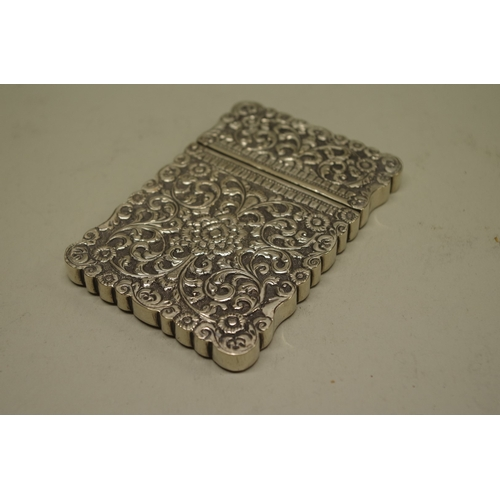 41 - <strong>A late 19th century Indian Kutch region white metal embossed card case</strong>, 10 x 7cm....