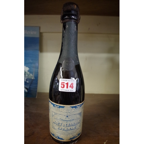 514 - <strong>An old half bottle of Moet & Chandon champagne.<br /></strong><em>Provenance: by repute ...
