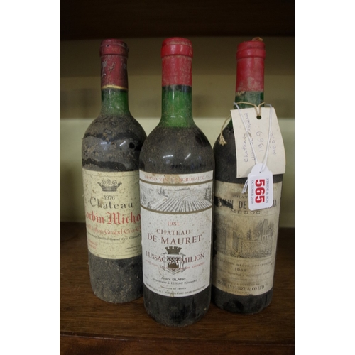 565 - <strong>Three bottles of French red wine,</strong> comprising: a 75cl Chateau Corbin Michotte 1976, ...