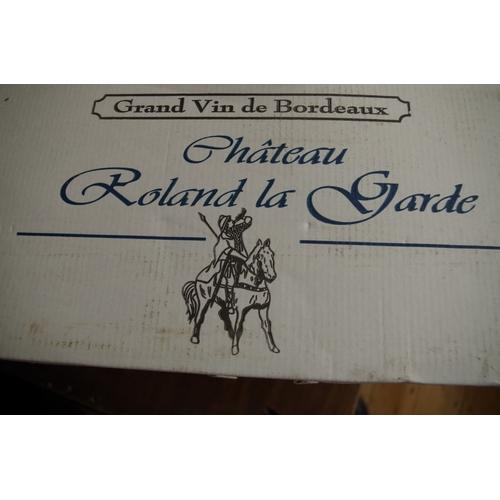 583 - <strong>A case of twelve 75cl bottles of Chateau Roland La Garde Tradition,</strong> 1998, 1er Cotes...