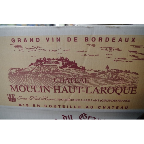 588 - <strong>A case of twelve 75cl bottles of Chateau Moulin-Haut-Laroque,</strong> 2005, Fronsac, in oc....