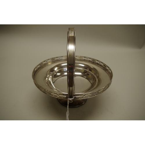 6 - <strong>A silver swing handled basket</strong>, by<em>John Round & Son Ltd,</em> Sheffield 1926...