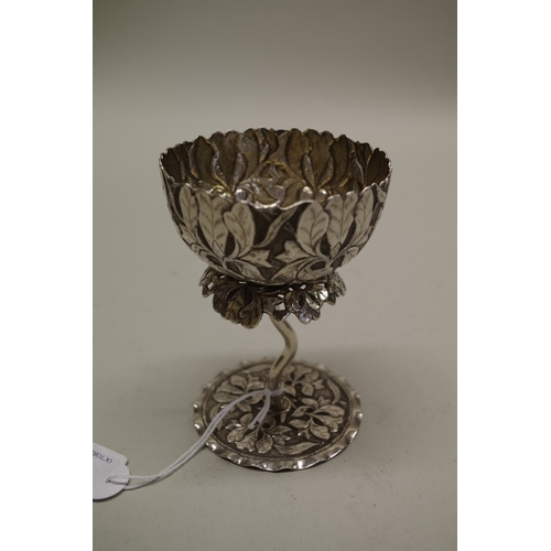 7 - <strong>An Indian white metal lotus flower goblet</strong>, having floral decoration, 12cm....