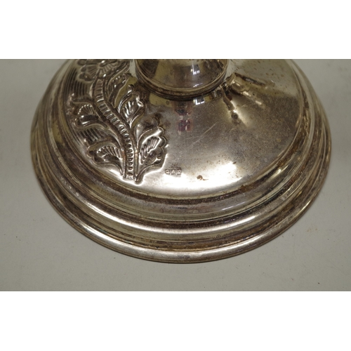 94 - <strong>An Indian white metal teapot;</strong> together with a pair of similar candlesticks....