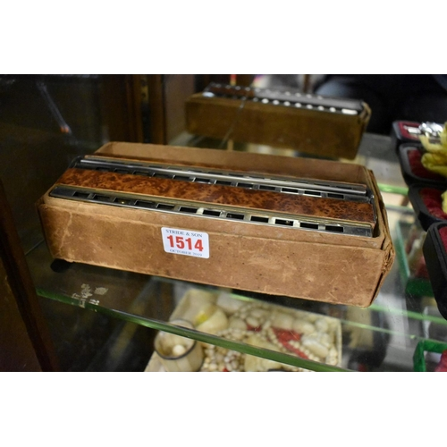 1385 - <strong>A Hohner 'Octave Base' harmonica,</strong>in card box....