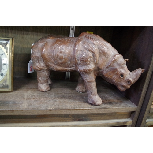 1576 - <strong>A Liberty style leather rhinoceros,</strong>32.5cm long....