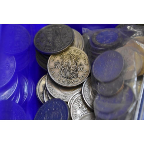 300 - <strong>Coins:</strong> a quantity of UK and world coinage, to include a few silver examples; and a ...