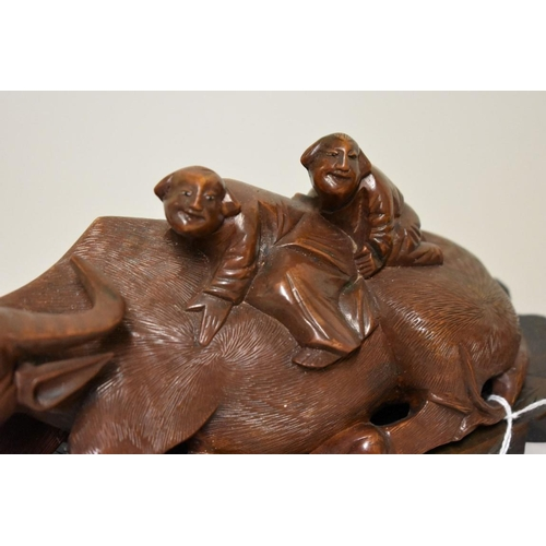513 - <strong>A pair of Chinese carved woodbuffalo figure groups,</strong><em>late 19th centur...
