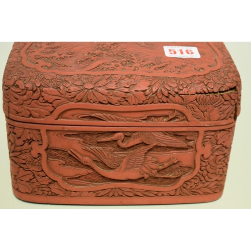516 - <strong>A cinnabar lacquer rectangular box and cover,</strong> relief decorated with cranes, 27cm wi...