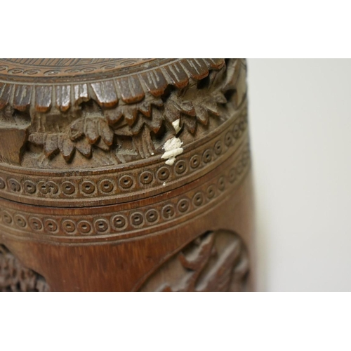 518 - <strong>A Chinese carved bamboo jar and cover,</strong> 14.5cm high; together with a Chinese hardwoo...
