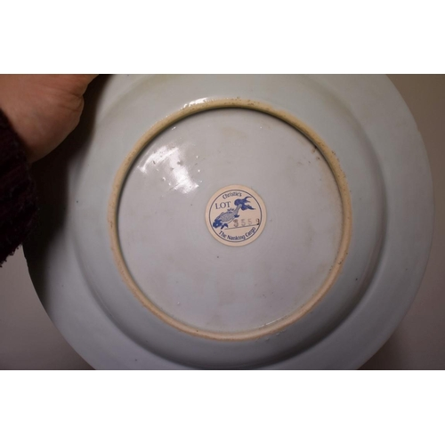 519 - <strong>A Chinese Nanking Cargo blue and white plate,</strong> 23cm diameter, (restoration to rim).<...