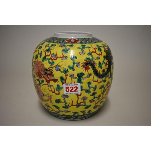 522 - <strong>A Chinese famille verte yellow ground jar,</strong> painted with two dragons and a flaming p...