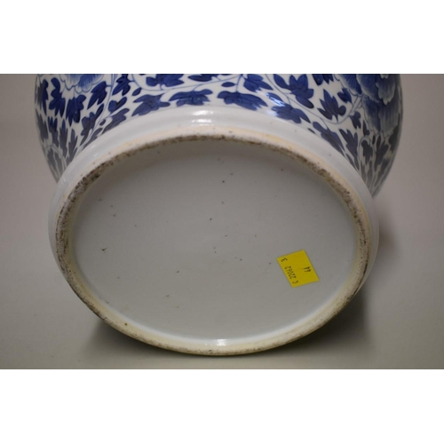 524 - <strong>A Chinese blue and white jar,</strong> <em>late Qing,</em> painted with peonies and scrollin...