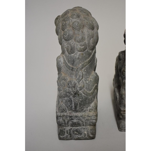 530 - <strong>A pair of Chinese green jade or soapstone lion dogs,</strong> 21.5cm high. (2)...