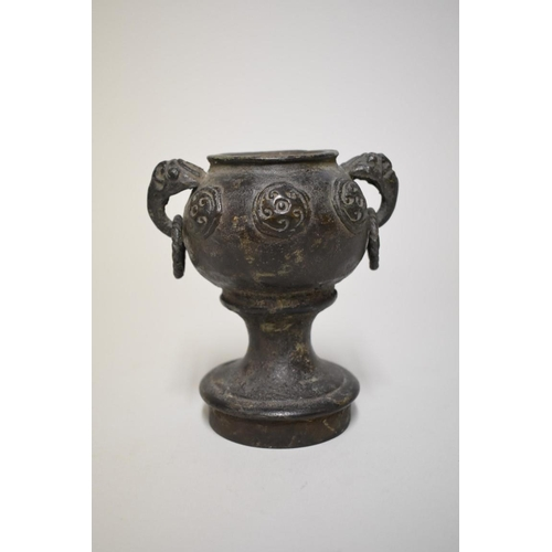 534 - <strong>An interesting and unusual Chinese Archaic twin handled dou or stem cup,</strong> relief dec...