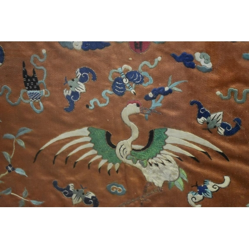 596 - <strong>A Chinese embroidered silk panel of cranes,</strong> <em>19th century, </em>28.5 x 60.5...