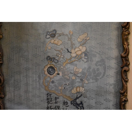 598 - <strong>A pair of Chinese embroidered silk panels,</strong> decorated with birds in branches ag...