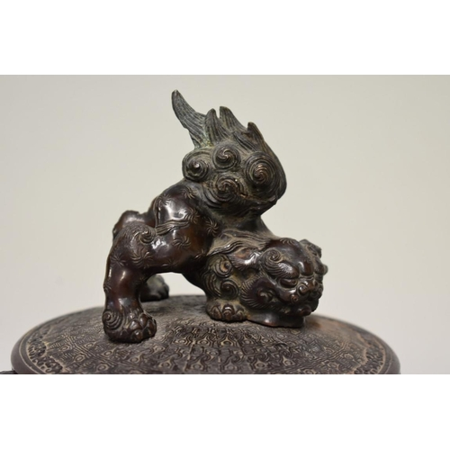 603 - <strong>An unusual Chinese bronze twin handled hexagonal censer and cover,</strong>with lion dog fi...