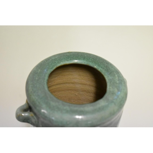 604 - <strong>A pair of Japanese stoneware vessels,</strong> marks to base, 7.5cm high; together with anot...