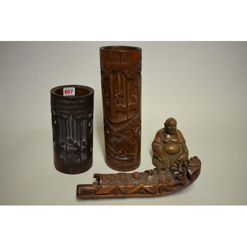 607 - <strong>Two Chinese carved bamboo vases</strong>, largest 32cm high; together with another carved ba...