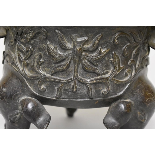 610 - <strong>A large Chinese bronze twin handled 'five elephant' tripod censer and cover,</strong><em> Mi...