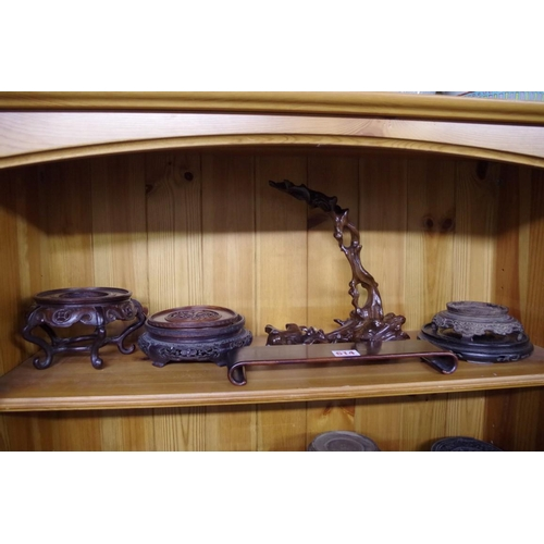 614 - <strong>A collection of eighteen Chinese hardwood stands;</strong> together with a part stand; three...