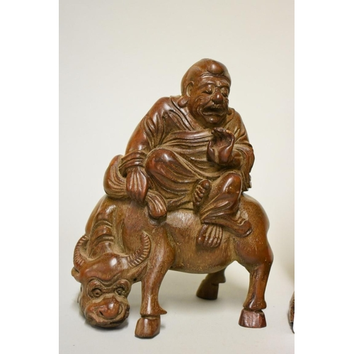 621 - <strong>A Chinese carved rootwood figure group,</strong> <em>Qing,</em>26cm high; together with ano...
