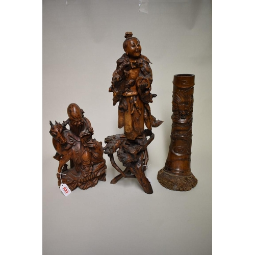 623 - <strong>A Chinese carved rootwood figure,</strong>54cm high; together with another Chinese carved w...