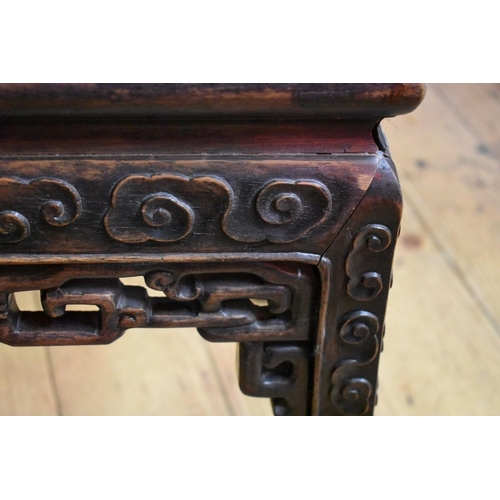 630 - <strong>A Chinese carved hardwood and marble top jardinière stand,</strong> 45cm high x 38cm wide....