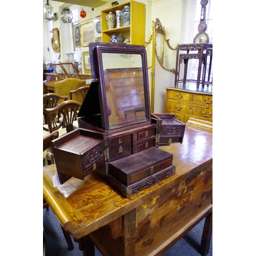 630A - <strong>A Chinese hardwood and brass mounted toilet box,</strong>25.5cm wide when closed....